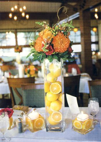 vases for centerpieces. lemons in tall centerpiece